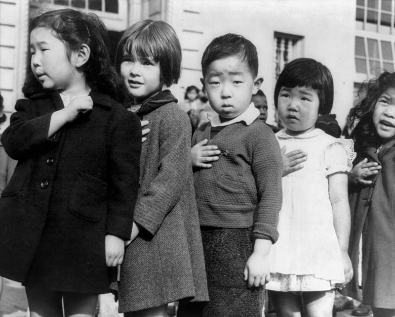 Dorothea Lange, Children at the Weill public school in San Francisco pledge allegiance to the American flag in April 1942, prior to the internment of Japanese Americans